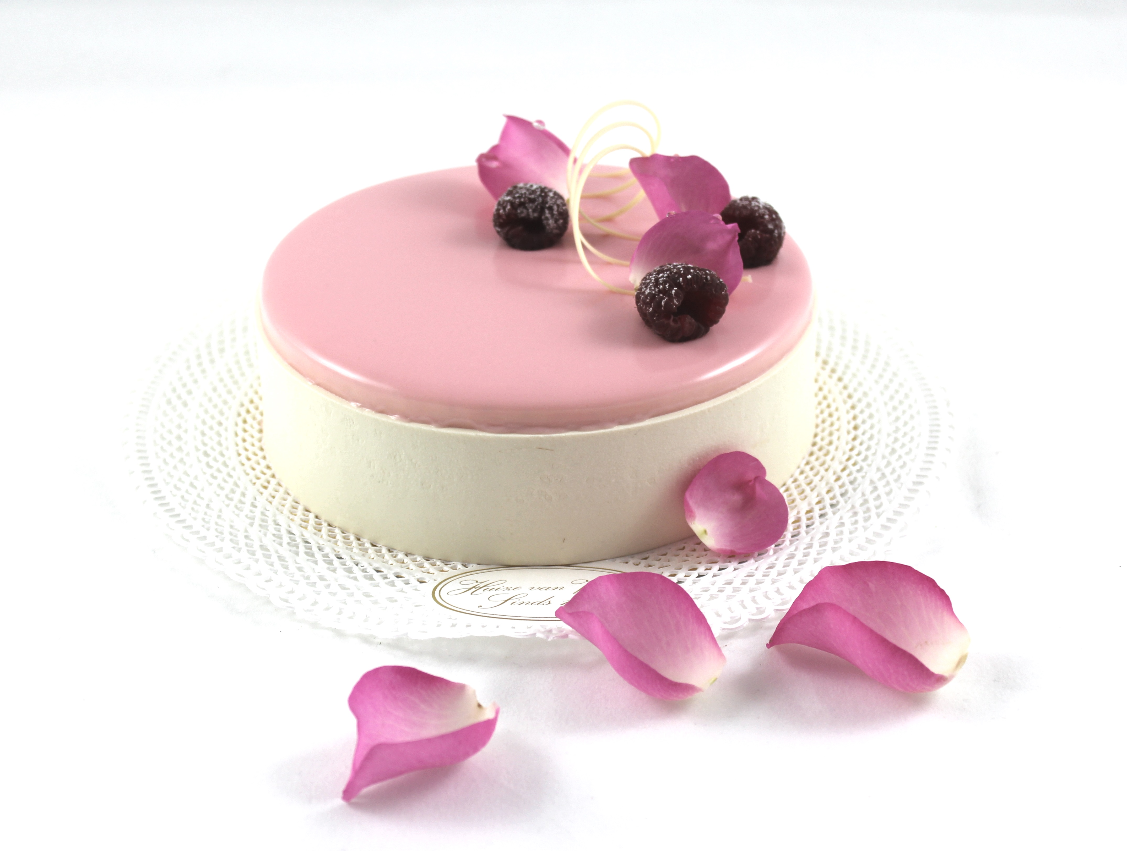 rose vanilla entremet with rose petals and raspberries