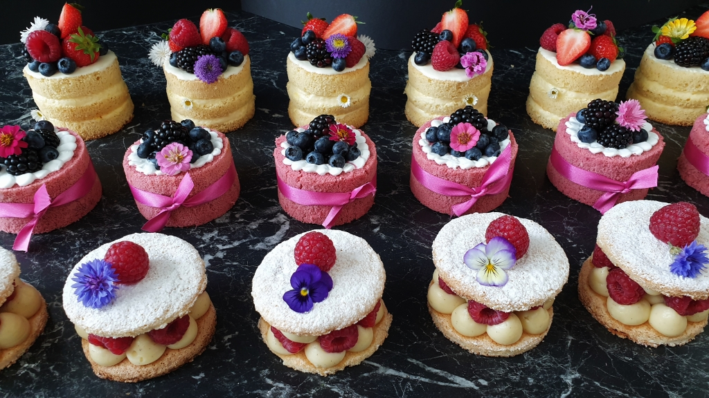 mini cakes for a wedding sweet table with flowers