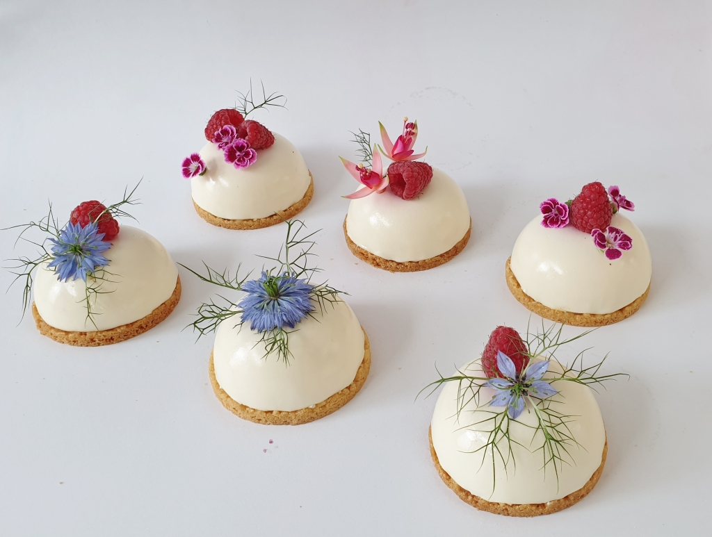 mini mousse cakes with edible flowers