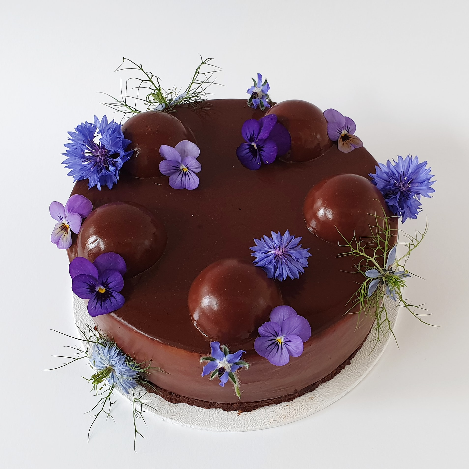 chocolate entremet with edible flowers